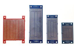 Prototyping board with breakaway mounting tabs